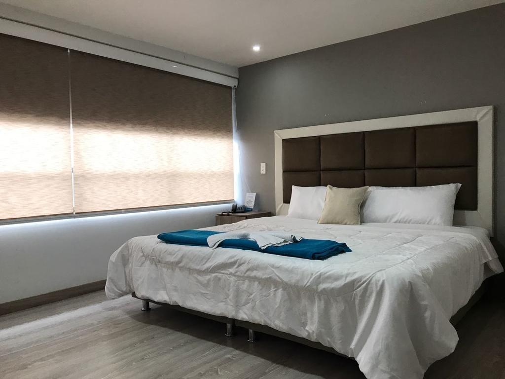 Quarto do Hotel Blue House Corferias